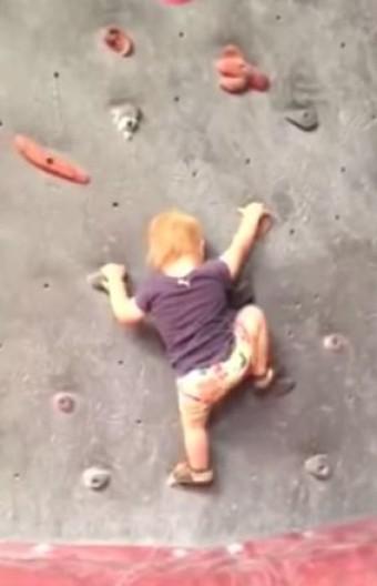 Baby Climbs Rock Wall